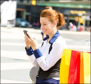 Woman Texting on City Street